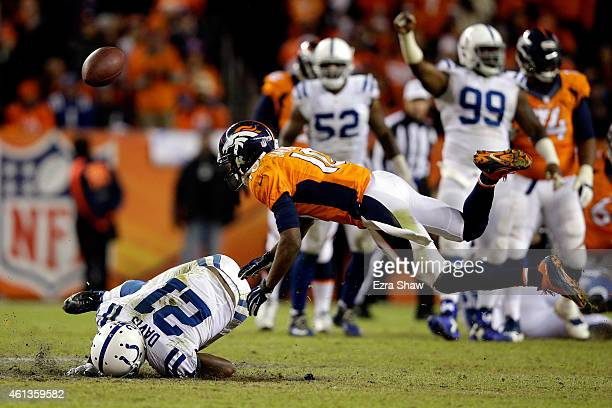 Vontae Davis of the Indianapolis Colts and Emmanuel Sanders of the Denver Broncos fall after a broken play during a 2015 AFC Divisional Playoff game...