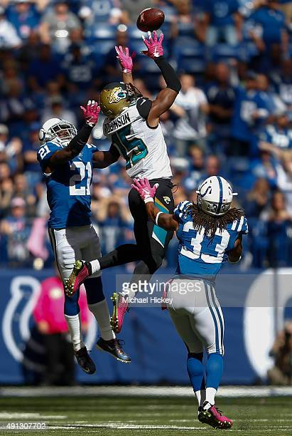 Vontae Davis of the Indianapolis Colts goes up for a tipped ball against Allen Robinson of the Jacksonville Jaguars at Lucas Oil Stadium on October...