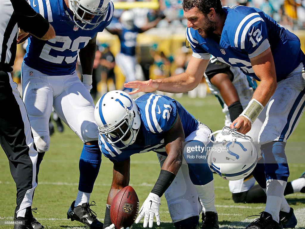Vontae Davis #21 of the Indianapolis Colts is congradulated by Andrew Luck #12 after intercepting the ball during the second half of the game against the Jacksonville Jaguars at EverBank Field on September 21, 2014 in Jacksonville, Florida.