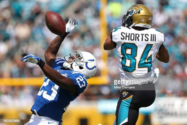 Vontae Davis of the Indianapolis Colts makes an interception over Cecil Shorts of the Jacksonville Jaguars during a game at EverBank Field on...