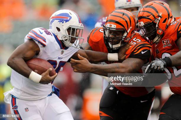 Vontaze Burfict of the Cincinnati Bengals and Pat Sims of the Cincinnati Bengals attempt to tackle LeSean McCoy of the Buffalo Bills during the third...