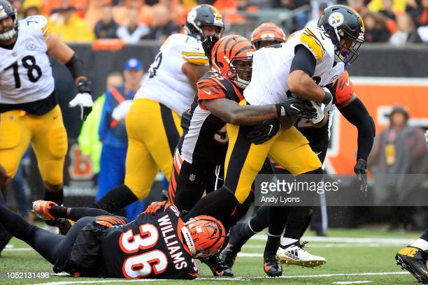 Vontaze Burfict of the Cincinnati Bengals and Shawn Williams combine to tackle James Conner of the Pittsburgh Steelers during the second quarter at...