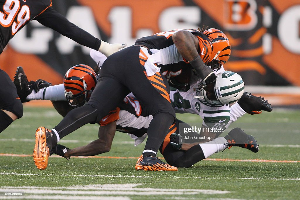 Vontaze Burfict #55 of the Cincinnati Bengals is called for a helmet to helmet tackle on Stephen Hill #84 of the New York Jets during their game at Paul Brown Stadium on October 27, 2013 in Cincinnati, Ohio. The Bengals defeated the Jets 49-9.