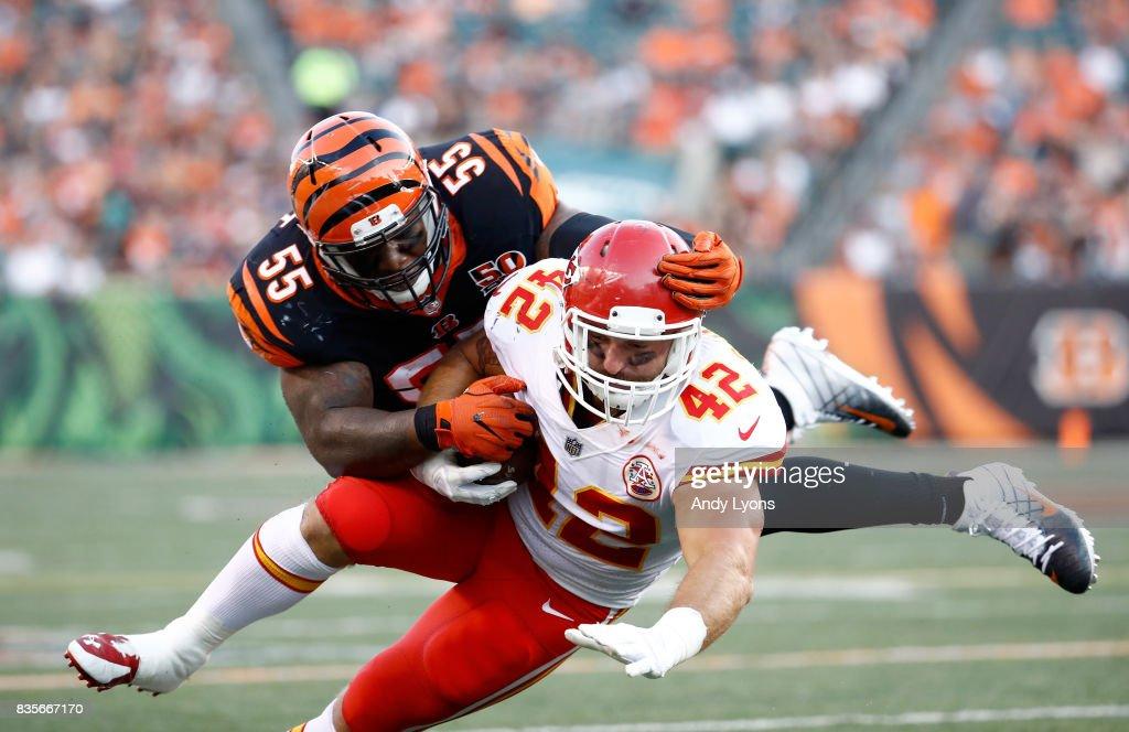 Vontaze Burfict #55 of the Cincinnati Bengals tackles Anthony Sherman #42 of the Kansas City Chiefs during the preseason game at Paul Brown Stadium on August 19, 2017 in Cincinnati, Ohio.