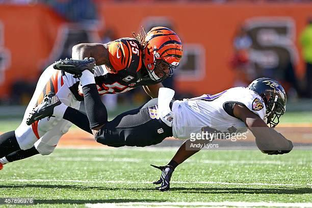 Vontaze Burfict of the Cincinnati Bengals tackles Justin Forsett of the Baltimore Ravens during the third quarter at Paul Brown Stadium on October 26...
