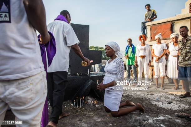 Voodoo faithful celebrate Baron Samedi during a ceremony commemorating the Day of the Dead at the Cemetery De Drouillard in Port-au-Prince on...