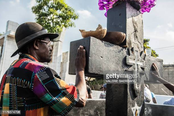 Voodoo faithful celebrate Baron Samedi during a ceremony commemorating the Day of the Dead at the National Cemetery in Port-au-Prince on November 1,...