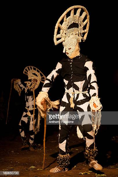 Voodoo fiber Masks from nigeria in the Festival des Masques de Dédougou in the night, in the festival there are including masks leaves, fiber masks,...