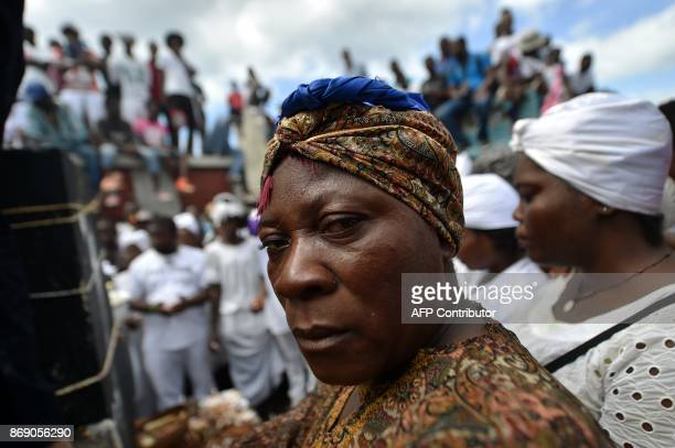 Voodoo followers take part in ceremonies honoring the Haitian voodoo spirit of Baron Samdi and Gede on the Day of the Dead in the Cementery of Cite...