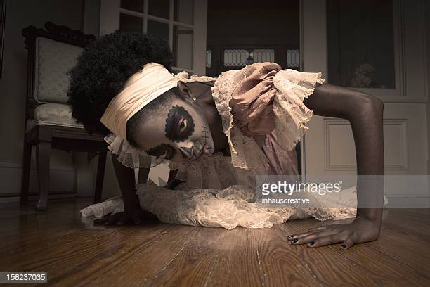 voodoo priestess crawling on the floor - african witch doctor stock photos and pictures