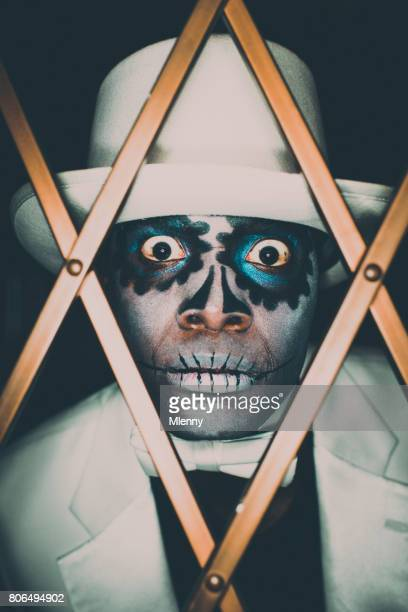 voodoo sugar skull spooky man portrait - new orleans stock photos and pictures