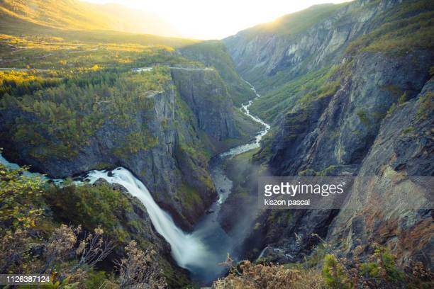 voringfossen waterfall in norway during sunset . scandinavia . - hordaland county stock pictures, royalty-free photos & images