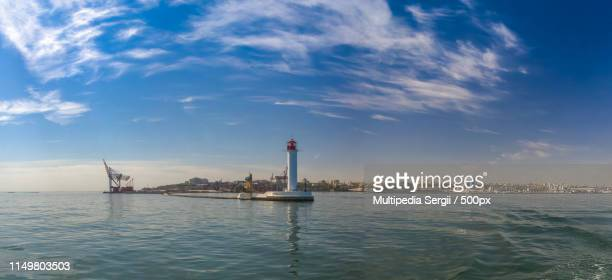 vorontsov lighthouse in the port of odessa, ukraine - odessa ukraine stock pictures, royalty-free photos & images
