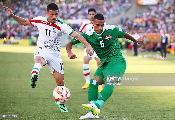 Vorya Ghafouri of Iran tackles Ali Adnan Kadhim of Iraq during the 2015 Asian Cup match between Iran and Iraq at Canberra Stadium on January 23 2015...