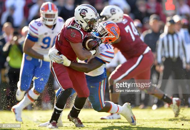 Vosean Joseph of the Florida Gators tackles AJ Turner of the South Carolina Gamecocks during their game at WilliamsBrice Stadium on November 11 2017...