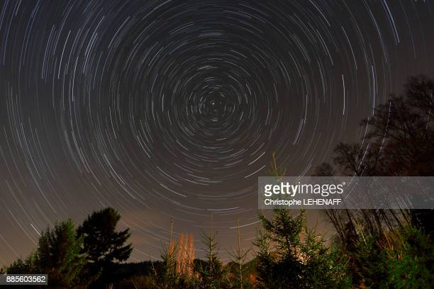 Vosges. Altenbach. The celestial vault during its rotation in winter. Shooting star.