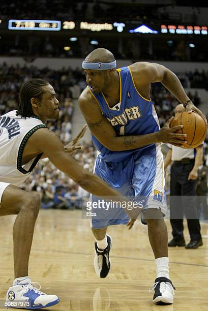 b454b3f9413 Voshon Lenard of the Denver Nuggets is covered by Latrell Sprewell of the  Minnesota Timberwolves in