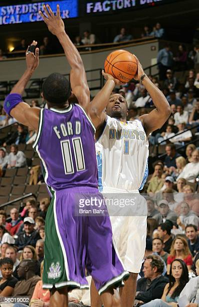 c1783b8211f Voshon Lenard of the Denver Nuggets takes a shot over TJ Ford of the  Milwaukee Bucks