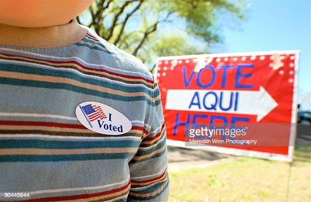 Vote Aqui sign and american flag sticker