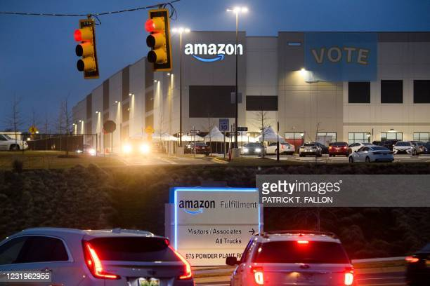 Vote banner hangs at an Amazon fulfillment center early on March 27, 2021 in Bessemer, Alabama. - Amazon Alabama workers are trying to unionize with...