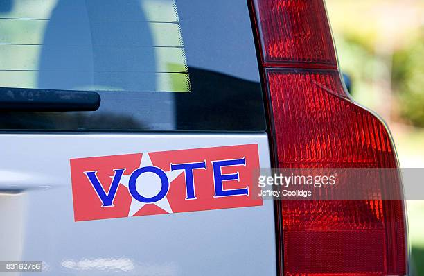 vote bumper sticker on car - bumper sticker stock photos and pictures