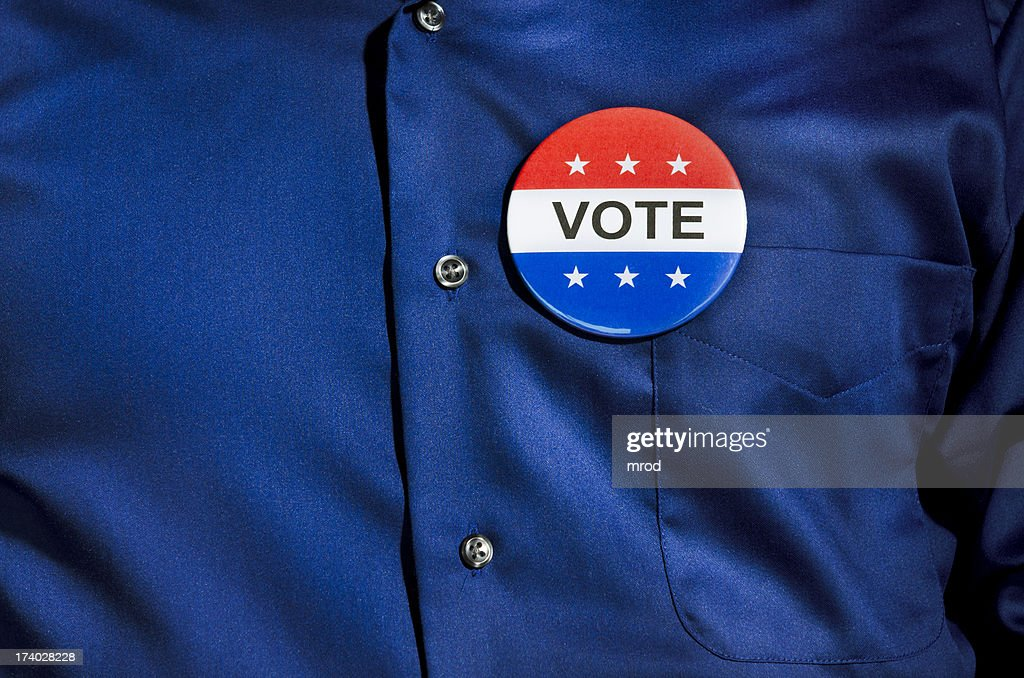 Vote Button on Blue Dress Shirt : Stock Photo