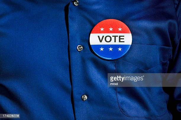 vote button on blue dress shirt - pin stock pictures, royalty-free photos & images