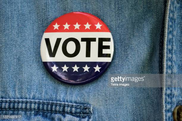 vote button on denim jacket - voting stock pictures, royalty-free photos & images