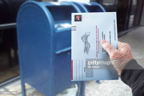 vote by mail: person mailing absentee ballot for voting - voting by mail stock pictures, royalty-free photos & images