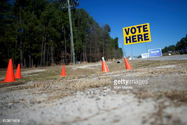 Vote Here and Bernie Sanders campaign yard signs greet voters at the Mallet Hill polling precinct for the South Carolina Democratic Presidential...