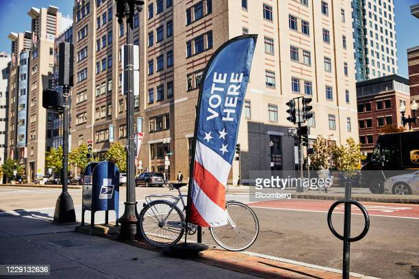 "Vote Here"" sign is displayed outside an early voting polling location for the 2020 Presidential elections in Boston, Massachusetts, U.S., on..."