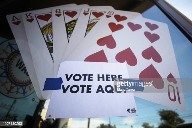 A 'Vote Here' sign is posted on the final day of early voting for the upcoming Nevada Democratic presidential caucus on February 18 2020 in Las Vegas...