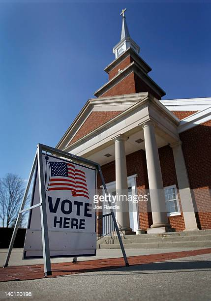 A Vote Here sign is seen outside the Emmanuel Bethel Church on primary day as Michigan residents head to the polls on February 28 2012 in Royal Oak...