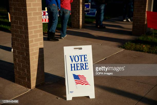 """Vote here"""" sign seen on Election Day 2020 at St. John the Apostle Catholic Church. Polling stations across the United States open for voters to cast..."""