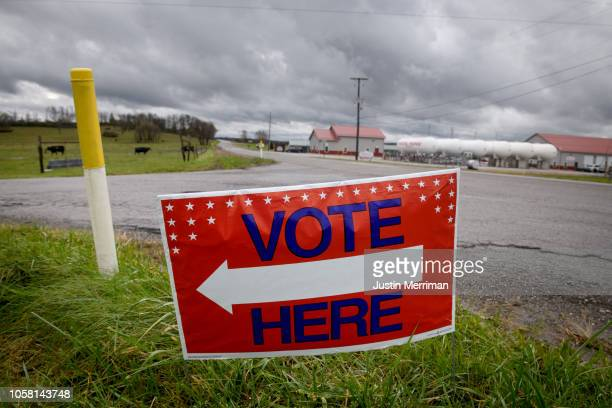 A 'Vote Here' sign sits along a road near a polling location on Election Day on November 6 2018 in St Clairsville Ohio Turnout is expected to be high...