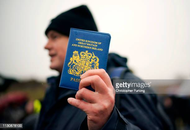 Vote Leave supporter holds up a blue UK passport in Grangetown, near Sunderland, at the beginning of the 'March to Leave' walk from the Port of...