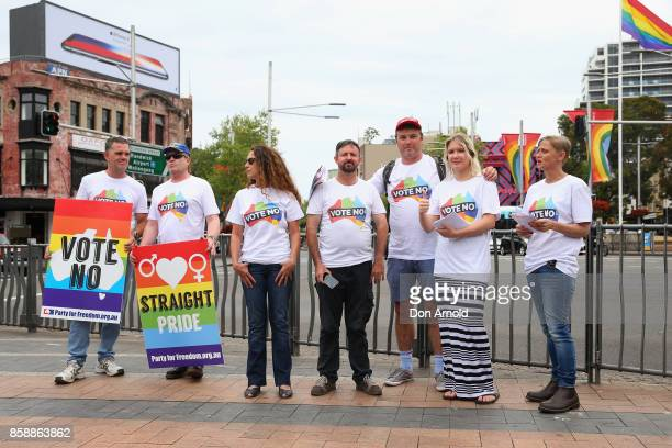 'Vote No' protesters look on quietly at a Marriage Equality rally in Taylor Square on October 8 2017 in Sydney Australia Australians are currently...
