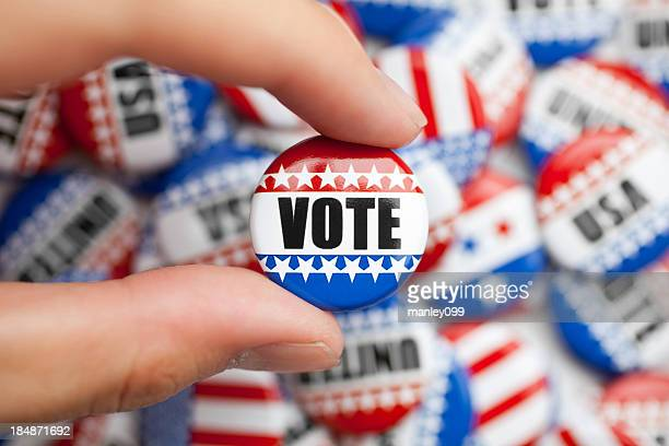 vote pin for american election - democratic party usa stock pictures, royalty-free photos & images