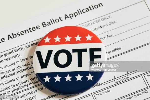 vote pin on absentee ballot application - presidential election stock pictures, royalty-free photos & images
