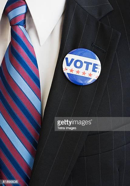 Vote pin on man?s lapel
