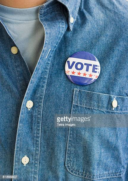 vote pin on man?s shirt - all shirts stock pictures, royalty-free photos & images