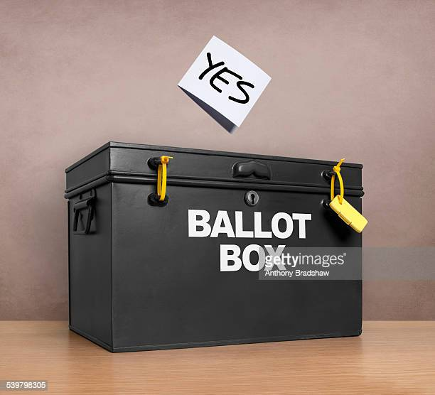 YES vote poised above the ballot box