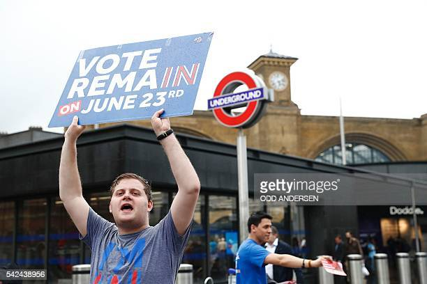 A 'Vote Remain' activist urges people to vote outside Kings Cross station in central London on June 23 as Britain holds a referendum on whether to...