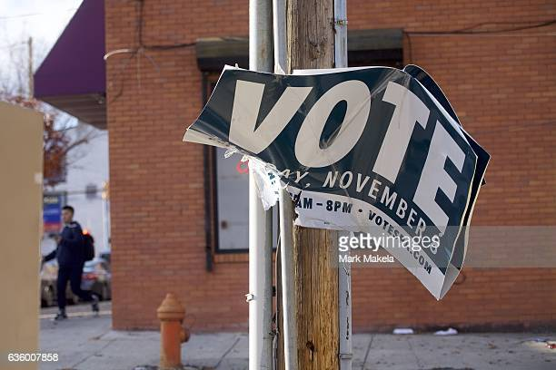 A vote sign hangs ripped from a telephone pole three weeks after election day December 1 2016 in Philadelphia Pennsylvania Republican Presidential...