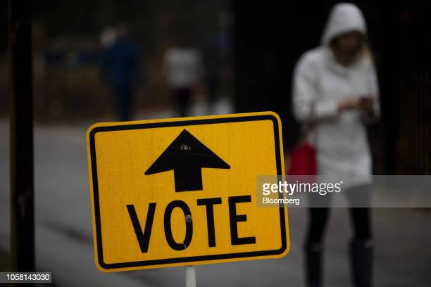 """Vote"""" sign stands outside a polling station at Hoyt Park Grand Hall in Wauwatosa, Wisconsin, U.S., on Tuesday, Nov. 6, 2018. More than 34 million..."""