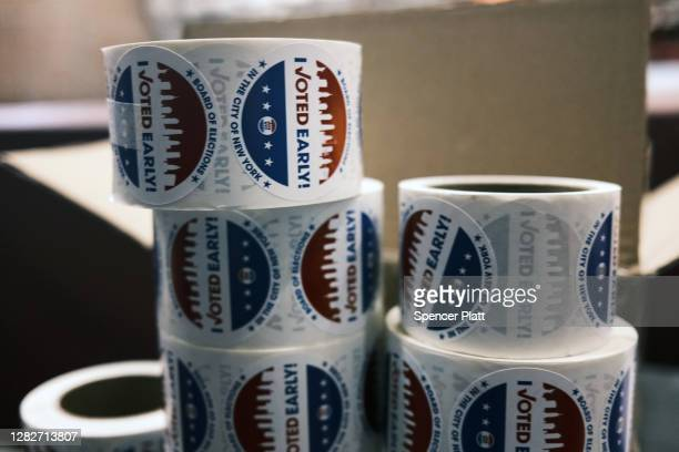 Voted early' stickers sit on a table at the Brooklyn Armory during early voting on October 28, 2020 in New York City. Election officials are trying...