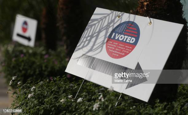 Voted' signs direct voters to a Vote Center located at the Staples Center on the first weekend of early in-person voting on October 25, 2020 in Los...