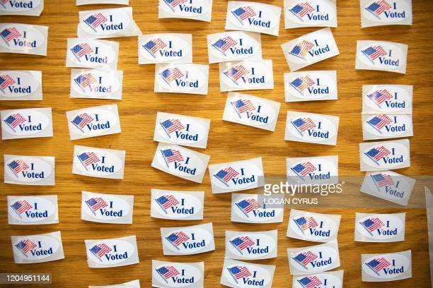 """Voted"""" stickers cover a table at a polling station during the North Carolina primary on Super Tuesday in Charlotte, North Carolina on March 3, 2020...."""