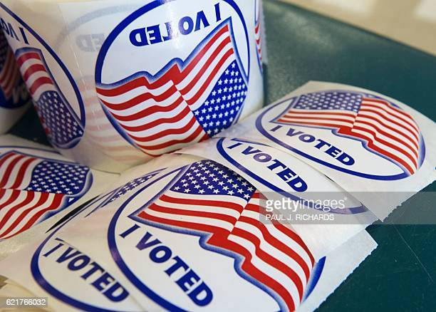 I voted stickers given to those who vote are seen November 8 at Colin Powwell Elementary School in Centreville Virginia Polling stations opened...