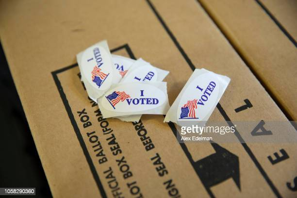 I Voted stickers rest on the top of a ballot box inside a polling location at a home on November 6 2018 in Modesto California This polling place is...